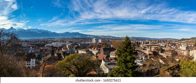 Stunning aerial panorama view of Thun cityscape from Thun Castle with snow covered mountain peaks of Swiss Alps on Bernese Oberland in background, a sunny autumn day, Thun, Canton of Bern, Switzerland