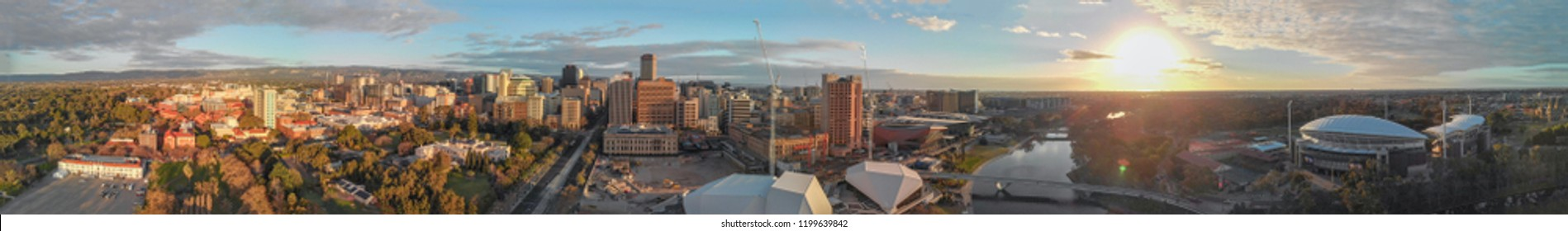 Stunning aerial panoramic view of Adelaide skyline at sunset, South Australia.