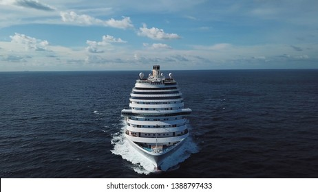 Stunning aerial view of the cruise ship in open water, front view. Stock. Front part of an anchored ocean liner sailing in the Pacific ocean.
