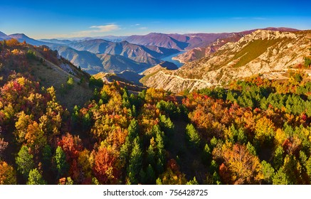 Stunning aerial view of lake Kozjak with mountain peaks around it in autumn. Drone photography.