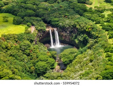 Stunning aerial view of Wailua Waterfall near the island capital Lihue on the island of Kauai, Hawaii. Wailua Falls is a 173 foot waterfall that feeds into the Wailua River. Seen from a helicopter.