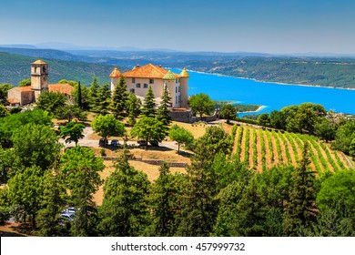 Stunning Aiguines castle,church with spectacular vineyard and beautiful turquoise St Croix lake in background,near Verdon gorge,Provence,France,Europe