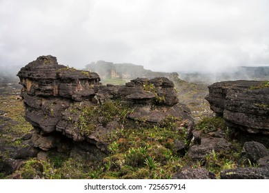 Stunning another planet looking like rocky terrain of mount Roraima covered with mysterious fog