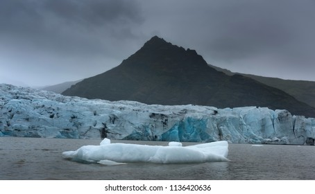 Stunning atmosphere of huge iceberg reflecting in the cool glacial water near the glacier. Glacial Lake jokulsarlon iceland, the Atlantic Ocean.