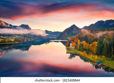 Stunning autumn view from flying drone of Grundlsee lake. Splendid morning scene of Eastern Alps, Liezen District of Styria, Austria, Europe. Traveling concept background.