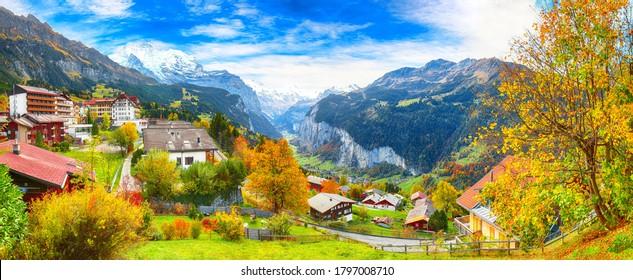 Stunning autumn view of picturesque alpine village Wengen with Jungfrau Mountain and Lauterbrunnen Valley on background. Location: Wengen village, Berner Oberland, Switzerland, Europe.