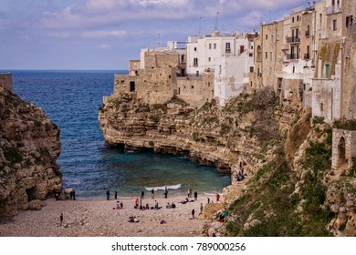 The stunning beach of Polignano a Mare on the Italian coast of Puglia, a small charming village built on top of the sea