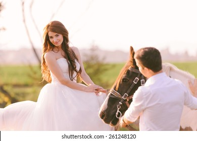 Stunning and beautiful bride riding a horse on her wedding day