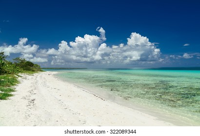 stunning beautiful gorgeous Cuban beach against deep blue sky and tranquil, turquoise ocean