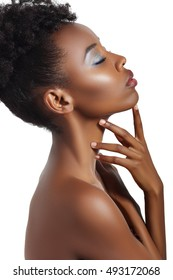 Stunning beautiful young african american black woman eyes closed. Beauty portrait. Afro hairstyle. Glamour makeup. White background. Studio shot.