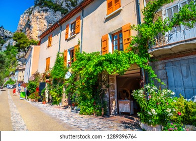 Stunning best village travel destination in Provence. Cute traditional Provence houses, decorated street with amazing mediterranean flowers, Moustiers-Sainte-Marie, Provence, France, Europe
