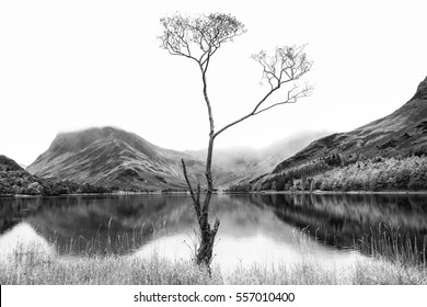 Stunning black and white high key landscape image of Lake Buttermere in Lake District England