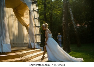 Stunning bride entrances elegantly a wedding pavilion
