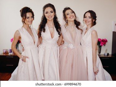 Stunning bride in ivory dress and bridesmaids in white dresses