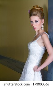 Stunning Bride Posing Against Wall In Long White Sequined Dress