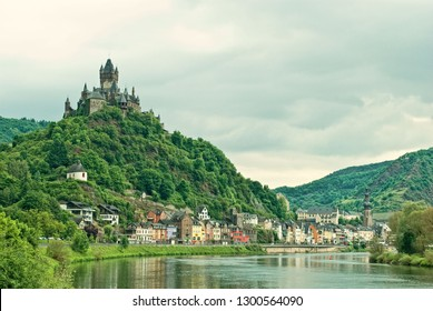 Stunning castle towering above the Cochem town and Moselle river