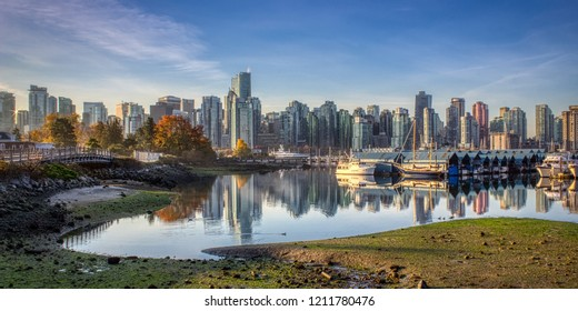 Stunning cityscape view of Vancouver skyline and Burrard Inlet from Stanley Park at sunrise in autumn, Vancouver, British Columbia