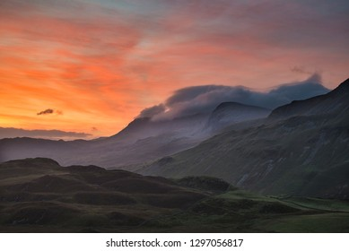 Stunning colorful landscape image of mountains around Cregennen Lakes in Snowdonia on Winter sunrise morning