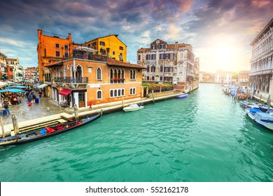 Stunning colorful medieval buildings,narrow canals with markets, souvenir shops and gondolas in the best touristic town, Venice, Veneto region, Italy, Europe