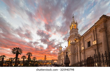 Stunning colorful sky at dusk in Arequipa, famous travel destination and landmark in Peru. Wide angle view from below of the colonial Cathedral.