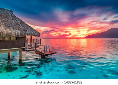 Stunning colorful sunset sky with clouds   on the horizon of the South Pacific Ocean. Lagoon landscape in Moorea. Luxury travel.