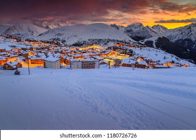 Stunning colorful winter sunset landscape and famous ski resort in French Alps, Alpe D Huez, France, Europe