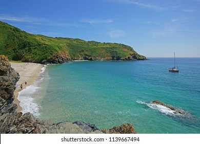 The stunning Cornish beach and coast line of Lantic Bay near Polruan in summer with holiday makers enjoying the sun, Cornwall, England, UK