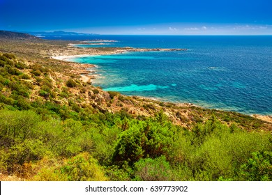 Stunning Corsica coastline with rocky beach and tourquise clear water near Ajaccio, Corsica, France, Europe.