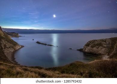 Stunning cove lit by star light, Dorset