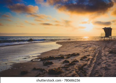 Stunning Crystal Cove beach at sunset with silhouette of lifeguard station, Newport Beach, California