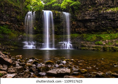 The stunning curtain waterfall of Sgwd yr Eira (fall of snow) along the four waterfall walk, waterfall country, Brecon Beacons, Wales