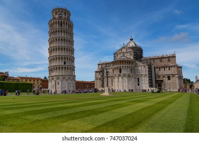 Stunning daily view at the Pisa Baptistery, the Pisa Cathedral and the Tower of Pisa. They are located in the Piazza dei Miracoli (Square of Miracles) in Pisa, Italy.