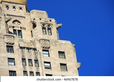 Stunning decorative architecture with birds and gargoyles framed by clear blue sky