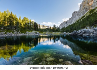 Stunning early morning view of Double Lake (Dvojno jezero) and Triglav Lakes Lodge (Ko?a pri Triglavskih jezerih) in the background, located in Triglav National Park in the Julian Alps,  Slovenia.