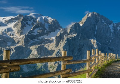Stunning early morning view of Marmolada mountain massif with Punta Penia and Gran Vernel peaks as seen from Viel del Pan refuge on Alta Via 2 trekking trail #601, Dolomites, Italy
