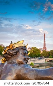 Stunning Eiffel Tower and Pont Alexandre III bridge (1896) spanning the river Seine. Decorated with ornate Art Nouveau lamps and sculptures it is the most extravagant bridge in Paris.