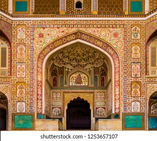 Stunning facade of Ganesh Pol entrance in Amber Fort Palace, Jaipur, Rajasthan, India