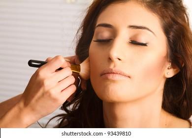 Stunning Female Having Makeup Applied