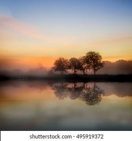 Stunning foggy Autumn  sunrise English countryside landscape image