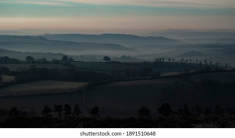 Stunning foggy and frosty sunrise landscape at Haddon Hill, Exmoor national park, Devon, UK