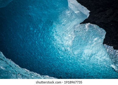 Stunning glacial ice formations in dazzling blues and whites float in a freshwater Icelandic glacial lagoon
