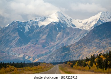 Stunning Haines Junction located in the northern Yukon Territory, Canada. Taken in the autumn with stunning yellow fall colored and snow capped mountains.