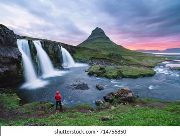 Stunning Icelandic landscape. Kirkjufellsfoss waterfall and Kirkjufell mountain. A famous tourist attraction near the city of Grundarfjordur