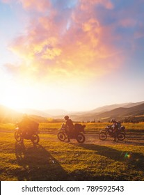 Stunning image of the group of bikers in the evening light. Picturesque and dramatic scene. Location Carpathians, Ukraine, Europe. Warm tone. Explore the world's beauty. Concept active extreme rest.