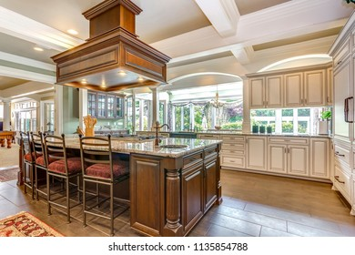 Stunning kitchen room design with large bar style island and coffered ceiling.