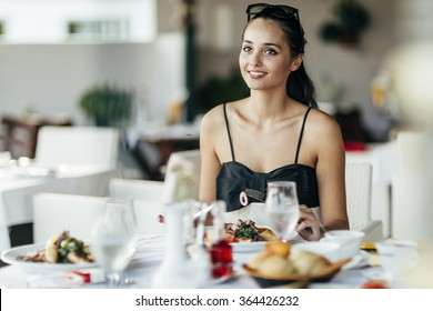 Stunning lady having lunch in restaurant