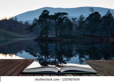 Stunning landscape image of Tarn Hows in Lake District during beautiful Autumn Fall evening sunset with vibrant colours and still waters coming out of pages in magical story book