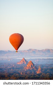Stunning landscape view of hot air balloons fly over thousands of ancient pagodas at morning in Bagan Myanmar