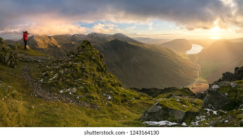 Stunning late afternoon winter light on top of Great Gable, in the Lake District looking towards Scafell Pike and Wastwater