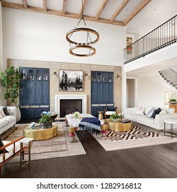 Stunning Living Room Interior in Luxury Home with Tall Ceilings with Wooden Beams, Fireplace, and Elegant Decor